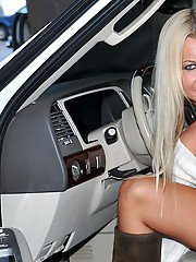 Classy blonde MILF Barbi Sinclair shows her superb legs in expensive white car.