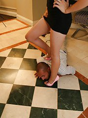 Sensuous femdom with sexy pink high heels being worshipped and licked