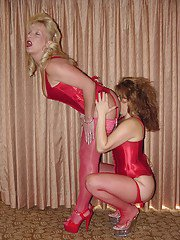 Two mature lesbians in high heels and stockings licking ass and sharing a dildo