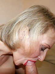 Mature blonde shows off her huge tits and gives blowjob while masturbating