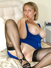 Hot mature lady with big tits spreading her fat legs and sucking a hard cock