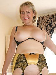 Chubby mom in black stockings and gold garters gets off masturbating