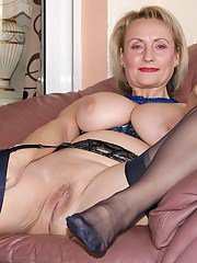 Naughty mom in classy lingerie strips and gives an amazing blowjob
