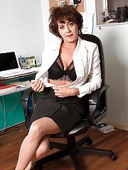 Busty mature secretary in gartered lingerie Jamy Nova masturbates in the office