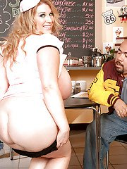 BBW waitress Renee Ross posing in tiny skirt with her massive boobs exposed