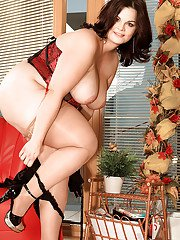 Brunette bbw in nylon stockings and embroidered lingerie posing solo