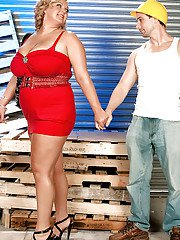 Busty blond bbw in red skirt gets caressed and kissed by a construction worker