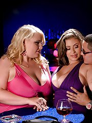 Two glamorous plumpers with fat tits kissing while mounting a stiff cock