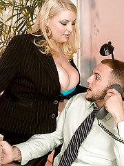 Heated secretary Scarlett Rouge gets her fat tits fucked by a long cock