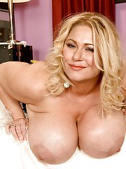 Mature fatty goes topless to play with her massive melons and huge dildo