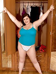 Lovesome plumper stripping to panties and flaunting her massive fat tits