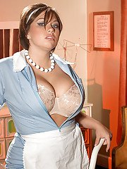 Seductive plump maid in uniform wiping dust and posing in nylon pantyhose