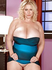 Chubby blond in blue miniskirt puts her fat tis and pink pussy on exposure