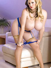 Ashley Sage Ellison poses in stockings in lingerie before a good rubbing.