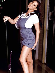 Cleaning lady with big boobs Linsey Dawn McKenzie shows her upskirt view.