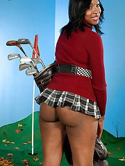 Lovesome girl in heels and miniskirt Kiki Carter playing golf and flashing ass