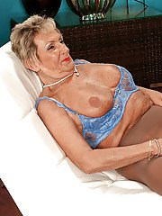 Tempting granny in nylon pantyhose Sandra Ann blowing big dick and masturbating