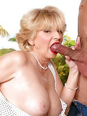 Busty mature blonde DeAnna Bentley gets throat fucked and nailed on a big cock