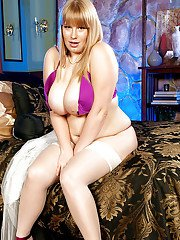 Platinum blonde BBW fatty Destiny Rose showed off her wonderful body in white stockings and purple sating lingerie.