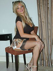 Seductive blonde vixen shows her incredible legs wearing sexy black stocking sand