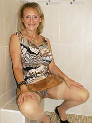 Horny blonde lady shows off her skin colored stockings as she passionately masturbates