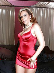 Busty glamorous MILF stripping from her dress and stuffing a thick dildo