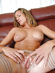 Mature slut Montana Skye showing off in stockings and flashing her big breasts
