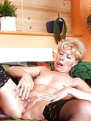 Raunchy mature Susan Lee taking off pink nighty and undies to expose old pussy