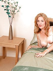 Mature mom in stockings and white underwear goes nude and squatting on a dildo