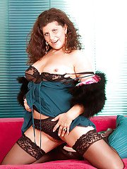 Chubby mature woman in stockings stuffing and vibrating her moist slit