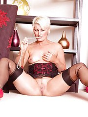 Mature bbw Sally Taylor posing in sexy underwear and flashing her pink
