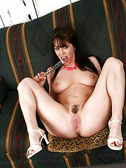 Hot brunette MILF lady with big tits toys her mature fanny.