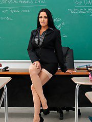 Brunette MILF teacher Vanilla DeVille posing in white stockings.