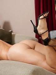 Hot latina MILF babe Monique Fuentes in high heels and sexy lingerie.