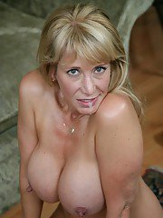 Big-ass blond milf Olivia Parrish seduces a hung young man