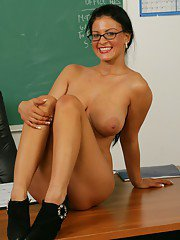 Brunette MILF teacher in glasses Marilyn Scott goes nude in the class