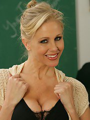 MILF teacher in glasses and high heels Julia Ann stripping on the table