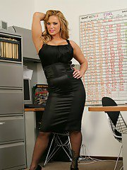 Tempting MILF in black stockings Shyla Stylez goes nude in the office