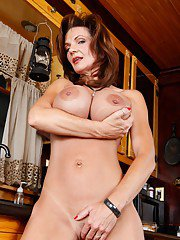 Mature babe with comely tits stripping from red lingerie and spreading