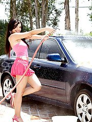 Young latina Sasha Bleu getting her tits and pussy wet at the carwash