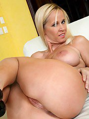 Blond MILF with huge melons Totally Tabitha caressing pussy in panties