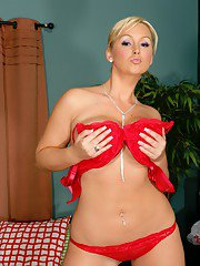 Hot wife Abbey Brooks stripping her shapely hooters from red lingerie