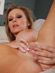 Busty mature Dyanna Lauren licking her tits with a finger in her pussy