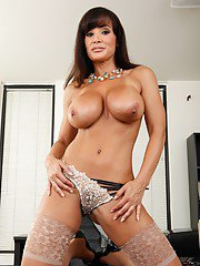 Comely MILF in stockings Lisa Ann exposing fabulous butt and boobs