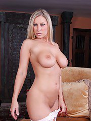 Blond MILF Devon Lee strips from white lacy lingerie and masturbates