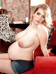 Pregnant blonde Kali West flashing fat tits and posing topless
