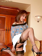 Sizzling mature Roni flashing boobs and posing in stockings and heels
