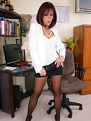 Seductive office babe strips to white underwear and black pantyhose