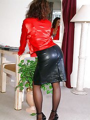 Curly mature lady Roni stripping from skirt and denudes breasts