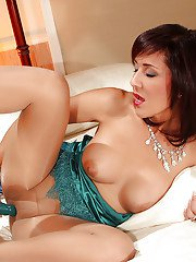 Tempting mature babe Roni using legs in pantyhose to play with a dildo